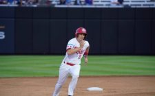 Larry Balkwill Homer Powers Dogs to 6-4 Victory
