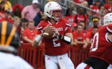 Erdmann Leads Johnnies Past Gusties, 33-21
