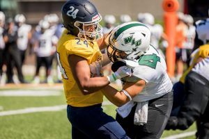 Crutcher, Muskies Defense Smothers Green