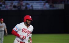 Keon Barnum Homers Twice to Lead Dogs to Victory